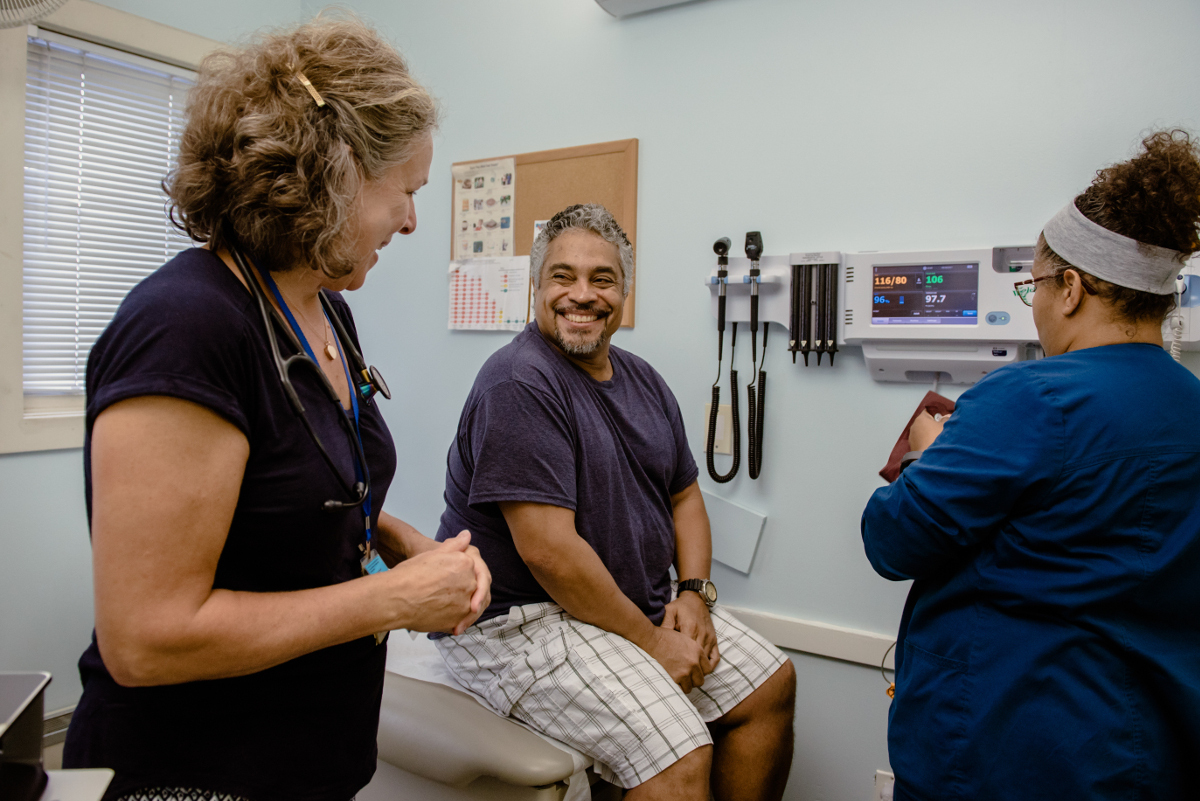 Patient talking to two nurses